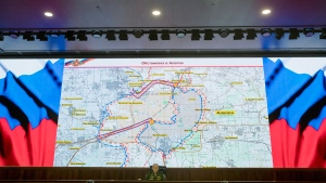 Lt. Gen. Sergei Rudskoi of the Russian military's General Staff speaks to the media, with a map of the area around Aleppo seen in the background, at the Russian Defense Ministry's headquarters in Moscow, Russia, on Oct. 17, 2016. (Pavel Golovkin / AP)