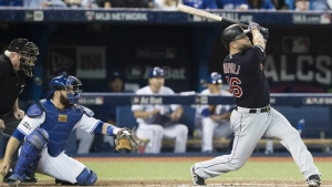 Cleveland Indians' Mike Napoli hits a solo home run during fourth inning, game three American League Championship Series baseball action against the Toronto Blue Jays in Toronto on Monday, October 17, 2016. (Mark Blinch / THE CANADIAN PRESS)