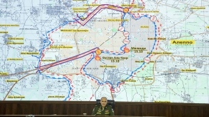 Lt. Gen. Sergei Rudskoi of the Russian military's General Staff speaks to the media, with a map of the area around Aleppo seen in the background, at the Russian Defense Ministry's headquarters in Moscow, Russia, Monday, Oct. 17, 2016. (AP / Pavel Golovkin)