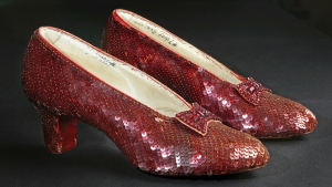 "This Nov. 9, 2001, file photo shows the sequin-covered ruby slippers worn by Judy Garland in ""The Wizard of Oz"" at the offices of Profiles in History in Calabasas, Calif. (AP / Reed Saxon, File)"