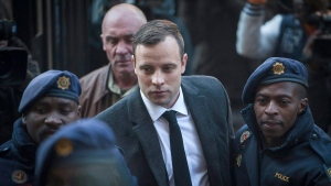 Oscar Pistorius, center, arrives at the High Court in Pretoria, South Africa, on July 6, 2016 for a sentencing hearing for the murder of his girlfriend Reeva Steenkamp in his home on Valentine's Day 2013. (Shiraaz Mohamed/AP)