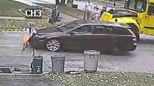Rebecca Hillier, 10, is nearly hit by a car as she crosses her home street on Sept. 29. (CTV Toronto)