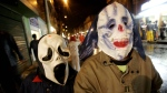 In this Tuesday, Oct. 31, 2009 file photo, two children dress in costume to celebrate Halloween. (AP / Fernando Vergara)