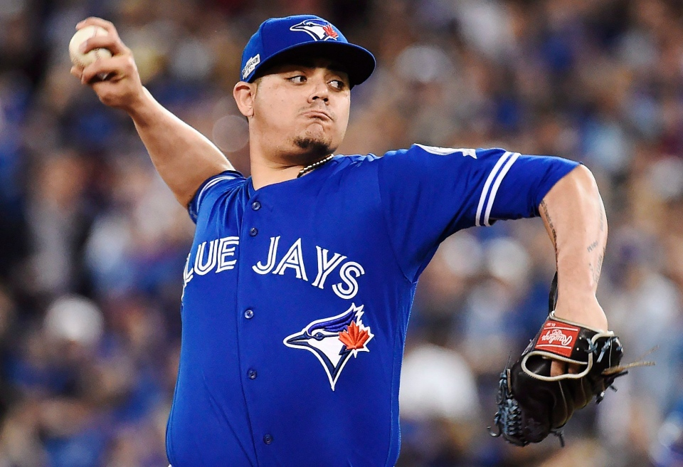 Toronto Blue Jays relief pitcher Roberto Osuna (54) pitches against the Cleveland Indians during ninth inning, game four American League Championship Series baseball action in Toronto on Tuesday, October 18, 2016. THE CANADIAN PRESS/Nathan Denette