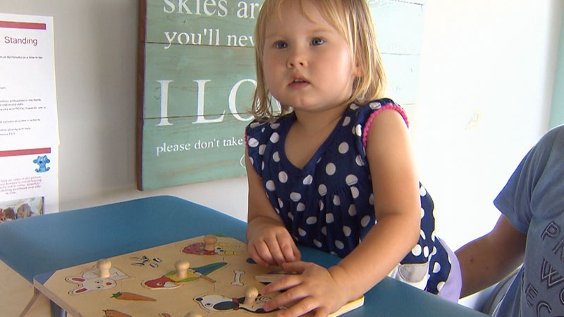 Julia Grassmick cannot walk on her own, but her parents are hopeful that therapy will help change her prognosis.