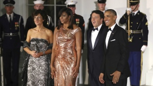 President Barack Obama and first lady Michelle Obama pose for pictures with visiting Italian Prime Minister Matteo Renzi and his wife Agnese Landini, left, upon arrival for a State Dinner at the White House in Washington, Tuesday, Oct. 18, 2016. (AP / Manuel Balce Ceneta)