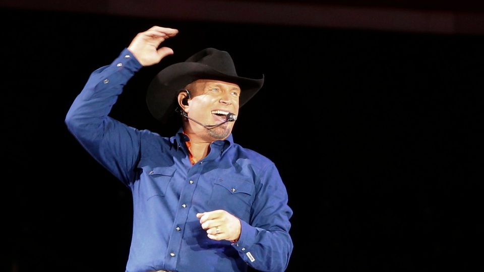 In this July 8, 2016 file photo, Garth Brooks sings 'Ain't Going Down' during a concert at Yankee Stadium in New York.  (AP Photo/Julie Jacobson, File)