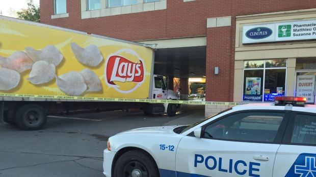 Truck hits building