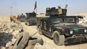 Iraqi Special Forces moving into liberated village of Badana on Wednesday, Oct. 19, 2016. (Paul Workman  / CTV News)