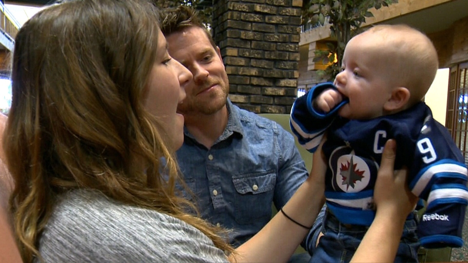 Clifford Anderson and Shalyn Meady are thrilled they won't have to buy an extra ticket to bring their seven-month-old son to the NHL Heritage Classic game in Winnipeg on Sunday.