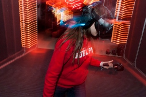 Vanessa Glavac plays a puzzle game at Ctrl V Virtual Reality Arcade in Waterloo, Ont. on Saturday, Oct. 15, 2016. Ctrl V is Canada's first virtual reality arcade and gaming hub. (Hannah Yoon / THE CANADIAN PRESS)