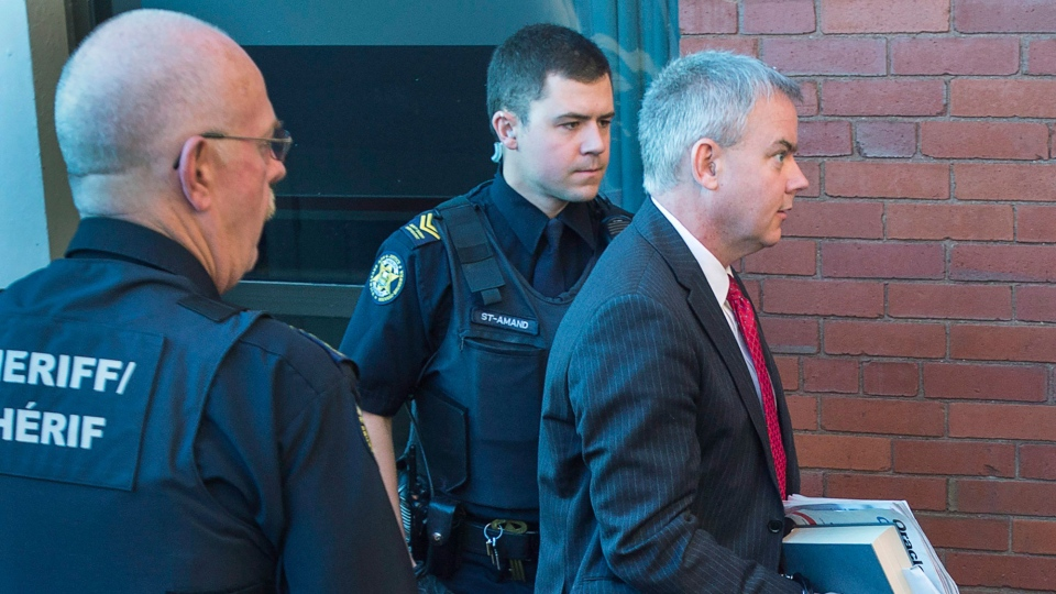 Dennis Oland arrives at the Court of Appeal in Fredericton on Wednesday, Oct. 19, 2016. Oland, convicted last December of second-degree murder and sentenced to life in prison with no eligibility for parole for at least 10 years in the death of his father Richard Oland, is appealing his conviction. (THE CANADIAN PRESS/Andrew Vaughan)