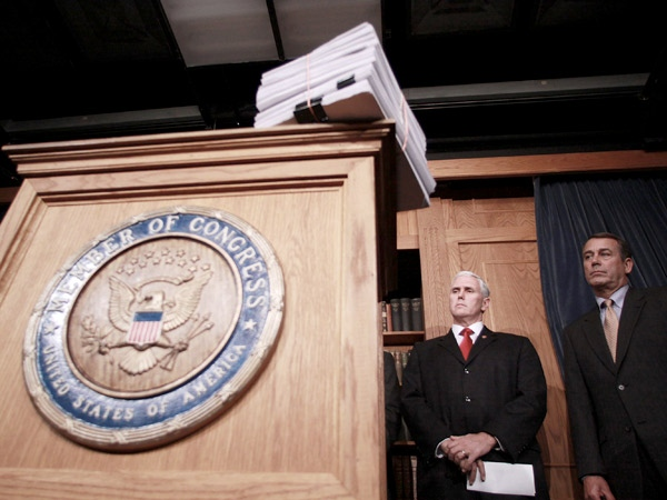 With a copy of the stimulus legislation on the podium, House Minority Leader John Boehner of Ohio, right, and Rep. Mike Pence, R-Ind., prepare to meet with reporters on Capitol Hill in Washington, on Friday, Feb. 13, 2009. (AP / Lauren Victoria Burke)