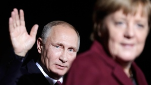President of Russia Vladimir Putin waves after he meets German Chancellor Angela Merkel at the chancellery in Berlin, on Oct. 19, 2016. (Markus Schreiber / AP)