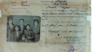 """This picture taken Oct. 1, 2016, shows part of the Najjar family's passport, Syrian migrants who came to the United States in 1920 and is displayed at the """"Little Syria, N.Y. An Immigrant Community's Life and Legacy"""" exhibit at the Ellis Island National Museum of Immigration.(AP Photo/Andres Kudacki)"""