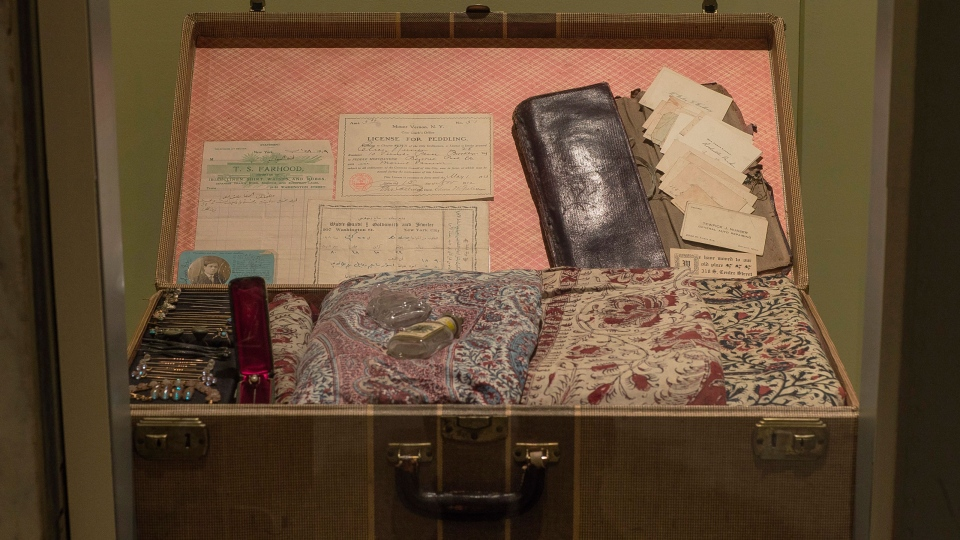 This picture taken Oct. 1, 2016, shows items on a case which once belonged to Joseph Nusser and his sons Joseph Jr. and Elias, peddlers who lived in Little Syria in lower Manhattan. (AP Photo/Andres Kudacki)