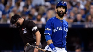 Toronto Blue Jays Jose Bautista walks back to the dugout after striking out against the Cleveland Indians during third inning, game four American League Championship Series baseball action in Toronto on Tuesday, October 18, 2016. (Nathan Denette/AP)