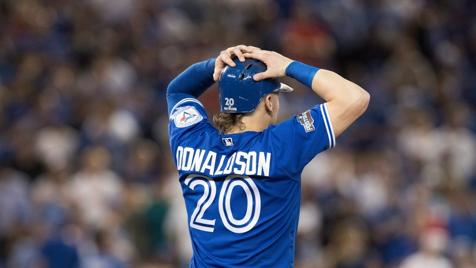 Toronto Blue Jays' Josh Donaldson watches the replay after hitting into an inning-ending double play after the call was challenged during sixth inning, game five American League Championship Series baseball action against the Cleveland Indians in Toronto on Wednesday, October 19, 2016.(Mark Blinch/The Canadian Press)