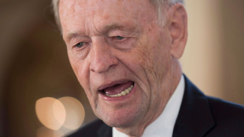 Former prime minister Jean Chretien speak with reporters following the burial of former President Shimon Peres in Jerusalem, Israel Friday September 30, 2016. (THE CANADIAN PRESS/Adrian Wyld)