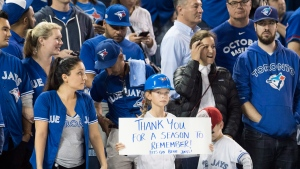 Toronto Blue Jays fans look on after the Cleveland Indians defeated the Blue Jays in game five American League Championship Series baseball action in Toronto on Wednesday, October 19, 2016. (Mark Blinch/The Canadian Press)