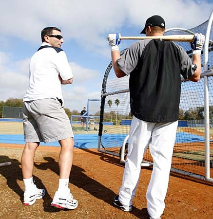 Toronto Blue Jays General Manager J.P. Ricciardi, left, speaks with second baseman Aaron Hill during an informal workout at the team's spring training facility in Dunedin, Fla., Saturday, Feb. 14, 2009. (The Canadian Press/Mike Carlson)