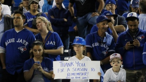 Toronto Blue Jays fans look on after the Cleveland Indians defeated the Blue Jays in game five American League Championship Series baseball action in Toronto on Wednesday, Oct. 19, 2016. (Mark Blinch / THE CANADIAN PRESS)