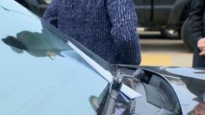 A note is shown on Paula Schultz's windshield outside a Original Joe's pub in Sherwood Park, Alta.