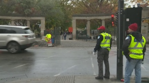 Montreal police officers direct traffic near McGill University (Oct. 20, 2016)