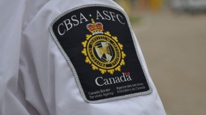 A Canada Border Services Agency badge is seen in this undated file photo.