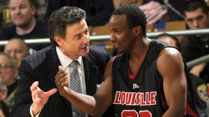 Louisville coach Rick Pitino, left, talks with guard Andre McGee during the first half of an NCAA college men's basketball game against Notre Dame in South Bend, Ind. on Feb. 12, 2009. (Joe Raymond/AP)