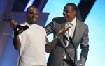 In this July 1, 2012, file photo, Kanye West, left, and Jay-Z accept the award for best group for 'The Throne' at the BET Awards in Los Angeles. (Photo by Matt Sayles/Invision/AP, File)