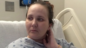 Fliss Cramman is shown in her hospital bed in Dartmouth, N.S., Thursday, Oct.20, 2016. Cramman, a 33-year-old woman facing deportation to the U.K., pleaded Thursday to be allowed to stay a day before a hearing that may shed light on her fate. (THE CANADIAN PRESS/Alison Auld)