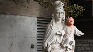 A statue is shown outside Ste. Anne des Pins parish in Sudbury, Ont., on Thursday Oct. 20, 2016. A statue of baby Jesus got a facelift after it was vandalized in northern Ontario - and the result is turning heads. (THE CANADIAN PRESS/Gino Donato)