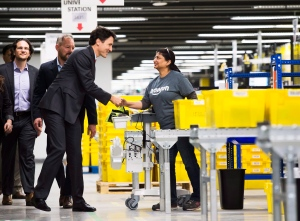 Prime Minister Justin Trudeau, second left, greets an employee at the new Amazon Fulfillment Centre before making an announcement in Brampton, Ont., on Thursday, Oct. 20, 2016. (Nathan Denette / THE CANADIAN PRESS)
