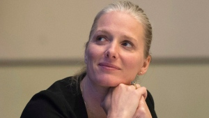 Minister of Environment and Climate Change Catherine McKenna listens as she is introduced as the keynote speaker at the Canadian Climate Forum Symposium in Ottawa, Thursday October 20, 2016. THE CANADIAN PRESS/Adrian Wyld