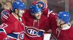 Montreal Canadiens' Alex Galchenyuk (27) celebrates with teammates Max Pacioretty (67) and Brendan Gallagher (11) after scoring against the Arizona Coyotes during second period NHL hockey action in Montreal, Thursday, October 20, 2016. THE CANADIAN PRESS/Graham Hughes