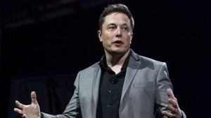Tesla Motors CEO Elon Musk unveils the company's newest products, in Hawthorne, Calif. on April 30, 2015. (AP / Ringo H.W. Chiu)