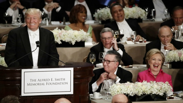 Republican presidential candidate Donald Trump, left, speaks at the 71st Annual Alfred E. Smith Memorial Foundation Dinner in New York as Democratic presidential candidate Hillary Clinton, right, watches, Thursday, Oct. 20, 2016. (AP / Frank Franklin II)