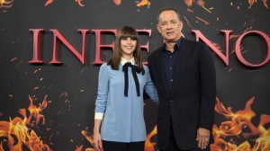 Actors Felicity Jones, left and Tom Hanks pose for photographers during a photo call for the film Inferno, based on Dan Brown's bestseller, in London, Wednesday, Oct. 12, 2016. (Photo by Joel Ryan/Invision/AP)