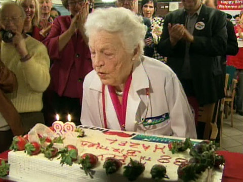 Mayor Hazel McCallion of Mississauga attempts to blow out the candles on a huge birthday cake at an event held on Saturday, Feb. 14, 2009 to mark her 88th birthday.