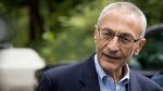 Hillary Clinton's campaign manager John Podesta speaks to members of the media outside Democratic presidential candidate Hillary Clinton's home in Washington on Oct. 5, 2016. (Andrew Harnik/AP)