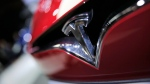 The logo of the Tesla model S is pictured at the Paris Auto Show in Paris, France, Friday, Sept. 30, 2016. (AP / Christophe Ena)