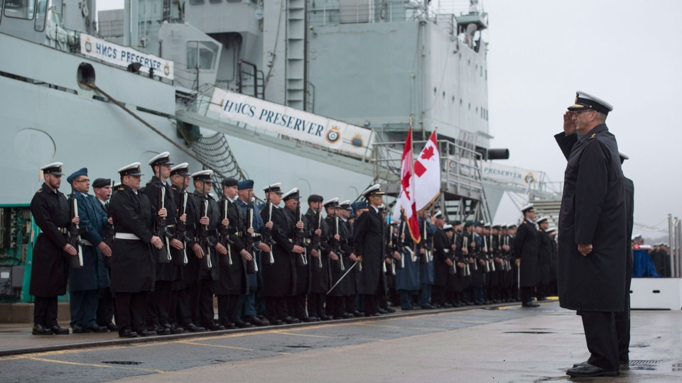 Rear-Admiral John Newton, right, Commander Maritime Forces Atlantic, salutes the crew of HMCS Preserver during the ship's paying-off ceremony at HMC Dockyard in Halifax on Friday, October 21, 2016. After more than four decades of service in the Royal Canadian Navy, HMCS Preserver received a final salute from current and former sailors, soldiers, airmen and airwomen. (THE CANADIAN PRESS/Darren Calabrese)