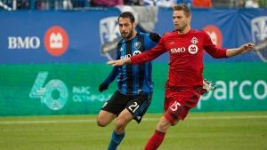 Montreal Impact's Matteo Mancosu, left, challenges Toronto FC's Eriq Zavaleta during second half MLS soccer action in Montreal, Sunday, October 16, 2016. (Graham Hughes/THE CANADIAN PRESS)