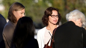 "Sabrina Erdely, centre, enters the federal courthouse in Charlottesville, Va., on Monday, Oct. 17, 2016. Erdely, author of ""A Rape on Campus,"" a discredited Rolling Stone article detailing an alleged rape at the University of Virginia, is being sued by Nicole Eramo, a university administrator included in the story. (Ryan M. Kelly/The Daily Progress via The Associated Press)"