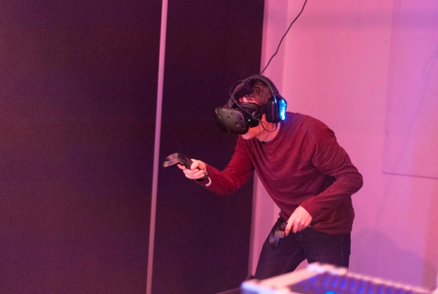 David Heppenstall plays a game at Ctrl V Virtual Reality Arcade in Waterloo, Ont. on Saturday, Oct. 15, 2016. (THE CANADIAN PRESS / Hannah Yoon)