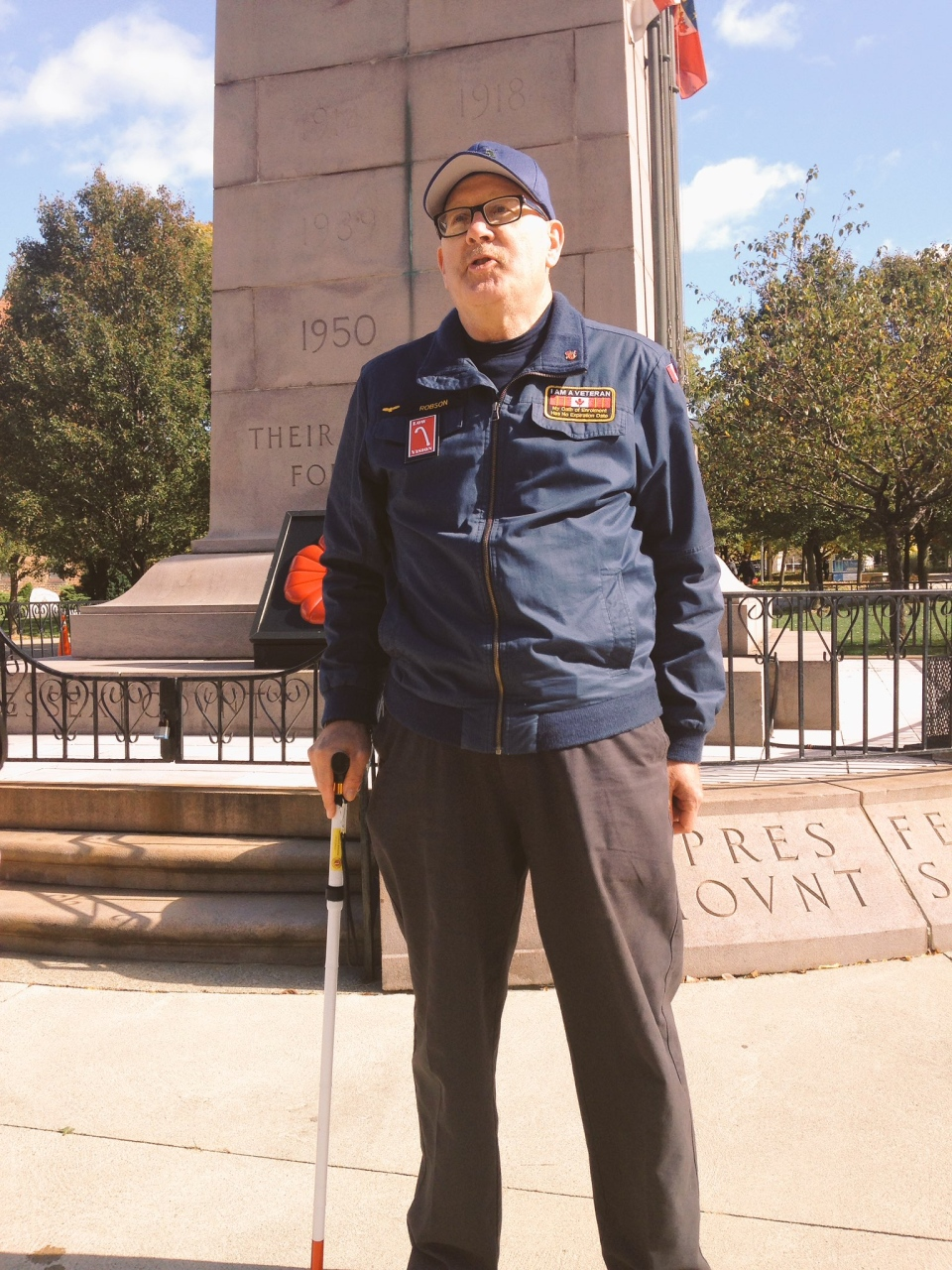 Veteran Kevin Robson stands guard at cenotaph