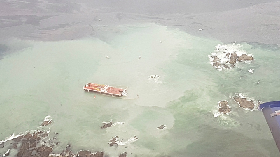 A tug boat that ran aground near British Columbia's Great Bear Rainforest is seen on Thursday, Oct. 13, 2016 in this aerial handout photo. THE CANADIAN PRESS/HO, Western Canada Marine Response Corp.