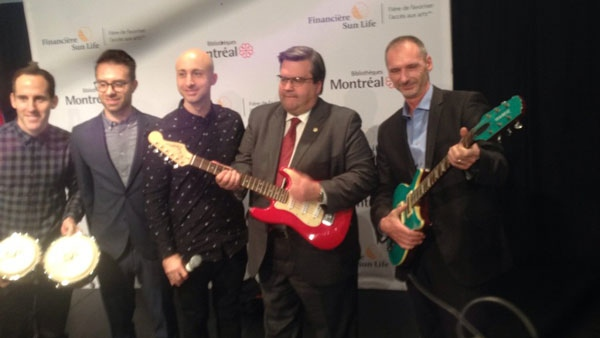 Montreal Mayor Denis Coderre poses with members of Simple Plan at the announcement of a musical instrument lending library. (photo: Annie Demelt / CTV Montreal)