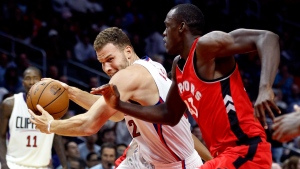 Los Angeles Clippers forward Blake Griffin, left, drives to the basket against Toronto Raptors forward Pascal Siakam (43), in Los Angeles, on Oct. 5, 2016. (Alex Gallardo / AP)